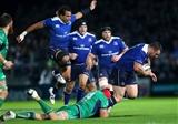 Leinster captain Isa Nacewa hurdles Quinn Roux as the Connacht lock tackles Cian Healy Credit: ©INPHO/James Crombie