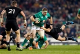 Aaron Cruden dives to halt the progress of Ireland's eager replacement hooker Sean Cronin Credit: ©INPHO/James Crombie