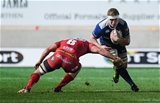 Dan Leavy, who started in the Leinster back row with Dominic Ryan and Jack Conan, is tackled by the Scarlets' Aaron Shingler Credit: ©INPHO/Craig Thomas